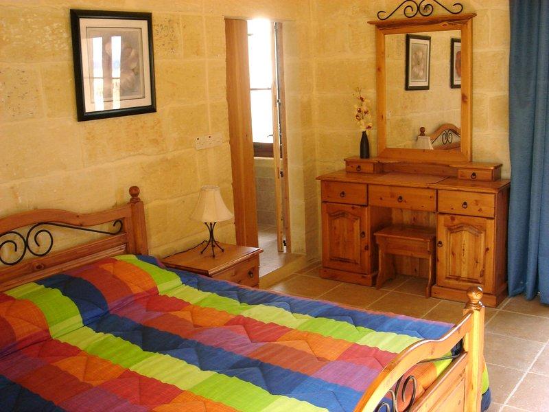 Double bedroom with en-suite bathroom and terrace