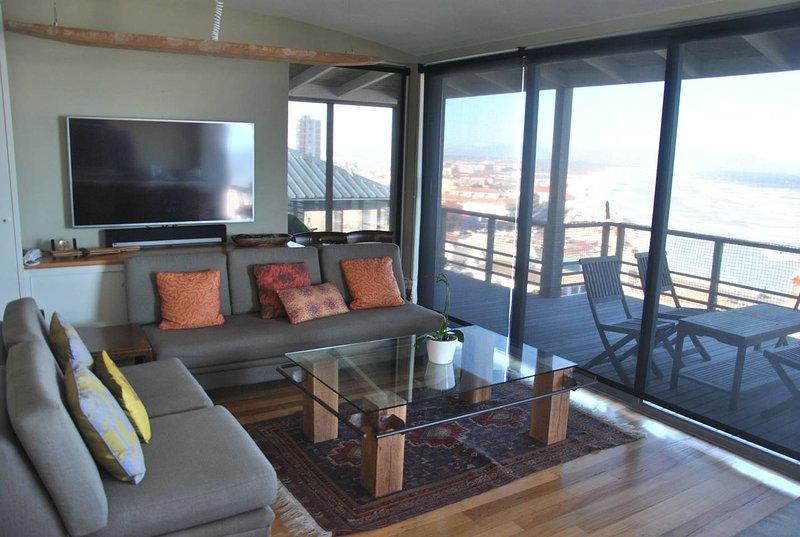 Lounge bovenwoning leiden naar buitendek