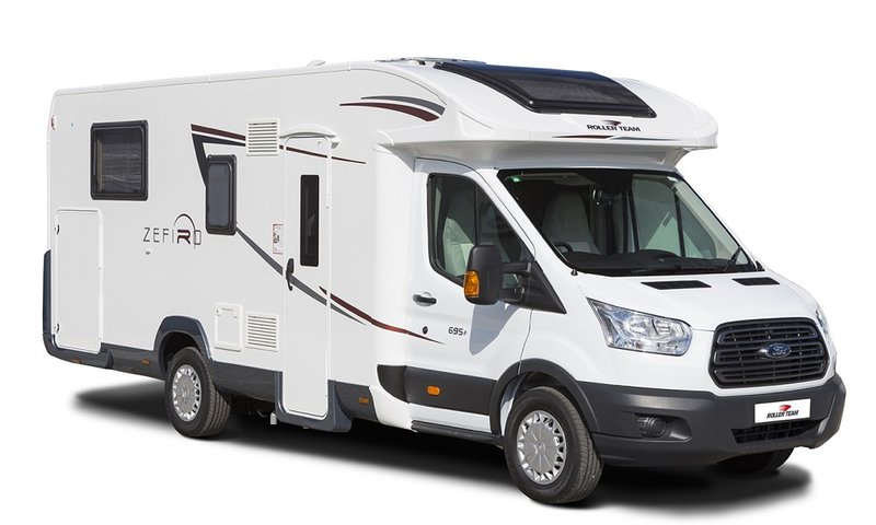 The 695 offers an island bed to the rear with 'his and hers' wardrobe space to either side. A separa