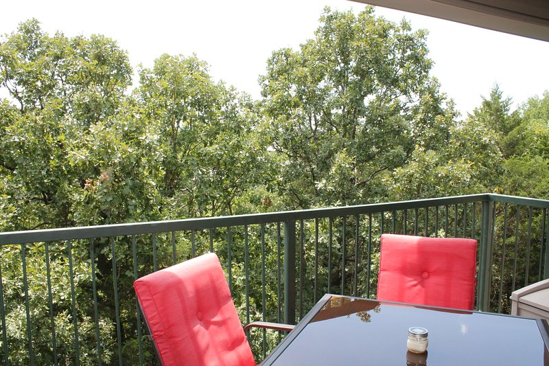 Enjoy our 4 comfy chairs and table on the balcony. Lovely view.