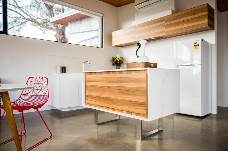 modern caesarstone and woodgrain kitchen
