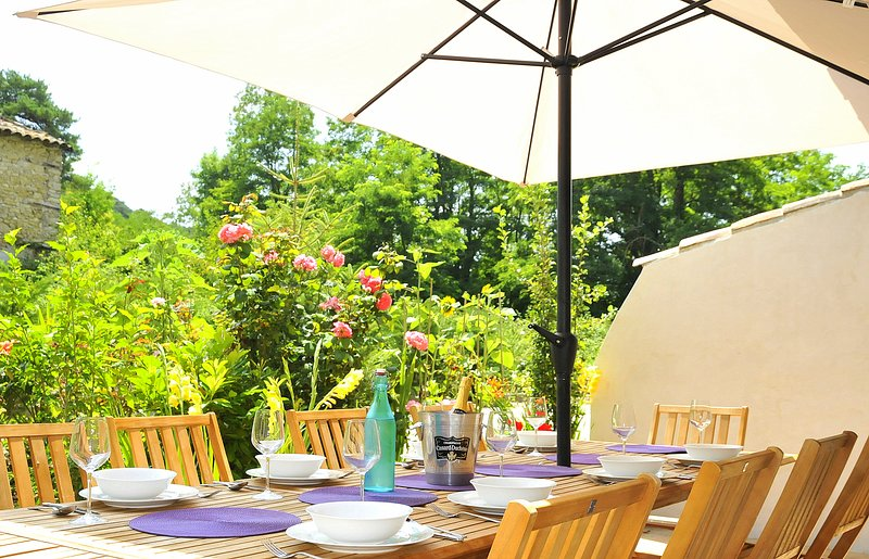 Sunny Terrasse with seating for up to 16. Next to kitchen and overlooking gardens