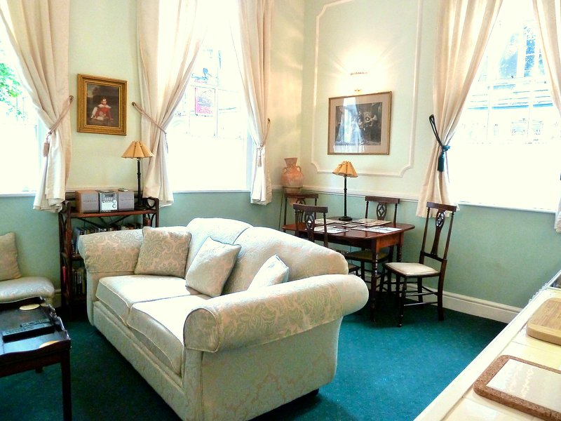 Bright and cheerful, but very old fashioned period sitting room.