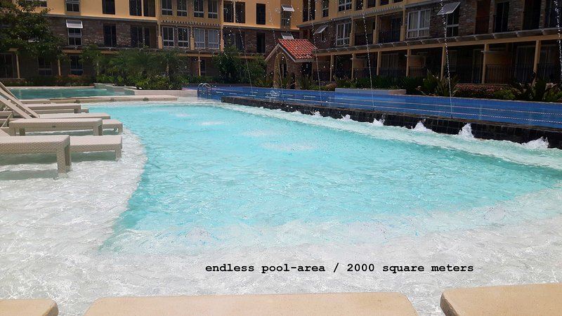 Brandnew Lux. 2-BR-condo near SM Seaside Megamall, vacation rental in Talisay City