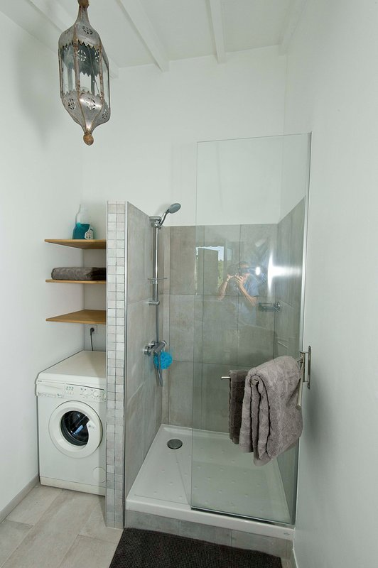 The shower room with washing machine
