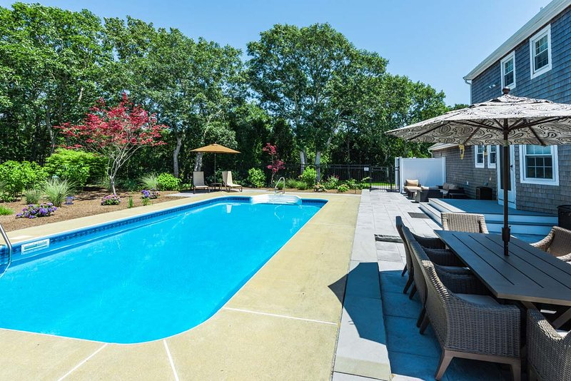 Outdoor dining area, pool and expansive patio area with out door enclosed shower