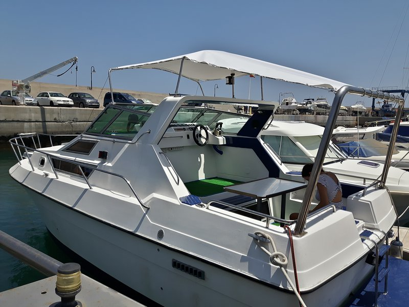 The stern has awning and table to be comfortably outdoors.