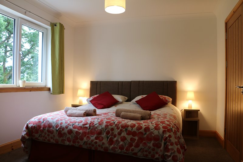 Twin bedroom with beds made up to a superking size bed.