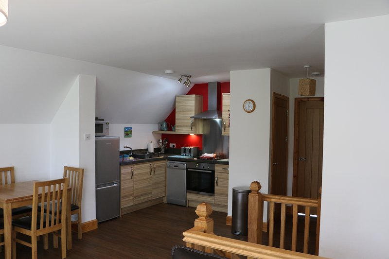 Kitchen & open plan living /dining area.