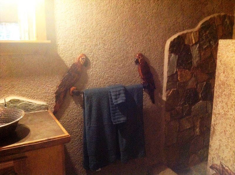 Custom bathroom with carvings and stone