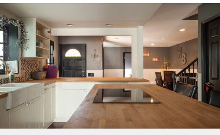 Great open layout . Kitchen is in between living room and dining room