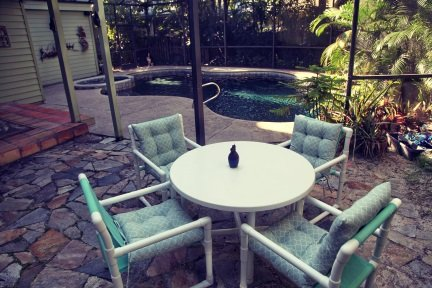 Enjoy some cool beverages on the fully screened patio and back porch, adjacent to the pool