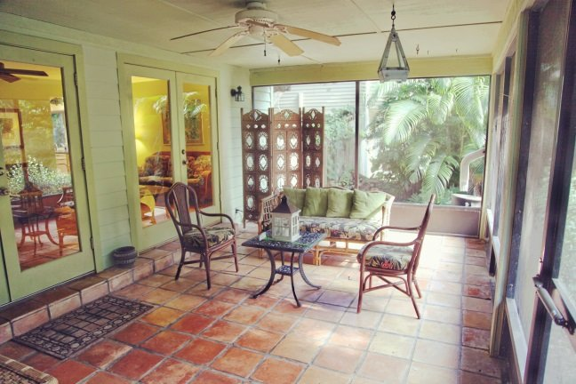 Chill out on the screened front porch, enjoy the landscape, the breeze and the quiet