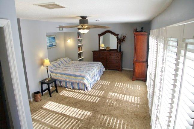 Huge master bedroom,  with king bed, plantation shutters, walk-in closet