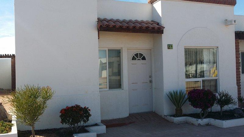 Front door is right in front of community Pool.