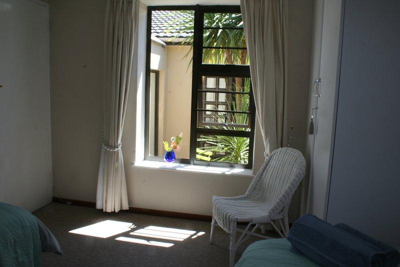 Twin bedroom looking onto inner courtyard
