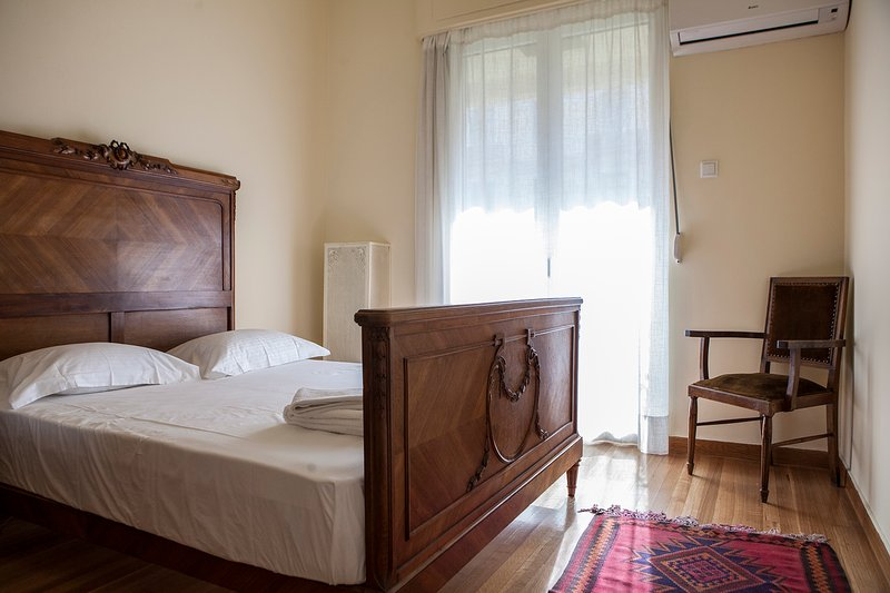 Unwind on the sunny, air-conditioned bedroom with Queen size bed