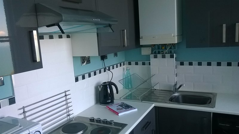 kitchen has washing machine, fridge freezer, microwave, hob, oven, toaster and most things