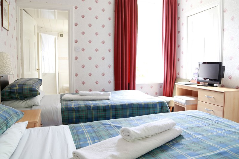 Twin (2 single beds) en-suite room with shower. Tea and coffee provided, small fridge, hairdryer.
