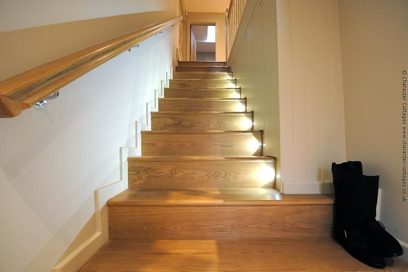 From the front door, walk up the LED lit staircase...