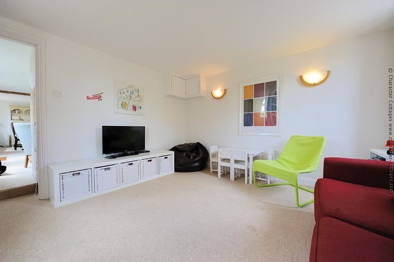 Additional play and TV room, just off the living room, ideal for children