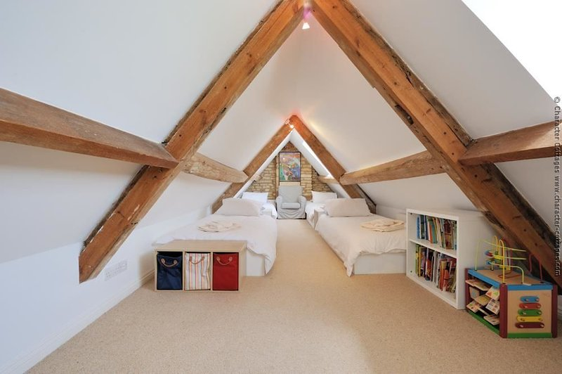 Bedroom 4, in the 2nd floor eaves, with single beds for two (+ the option of two extra beds for children)