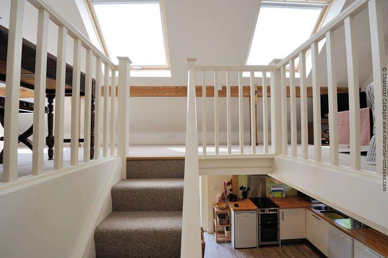 Staircase to the open plan upper level