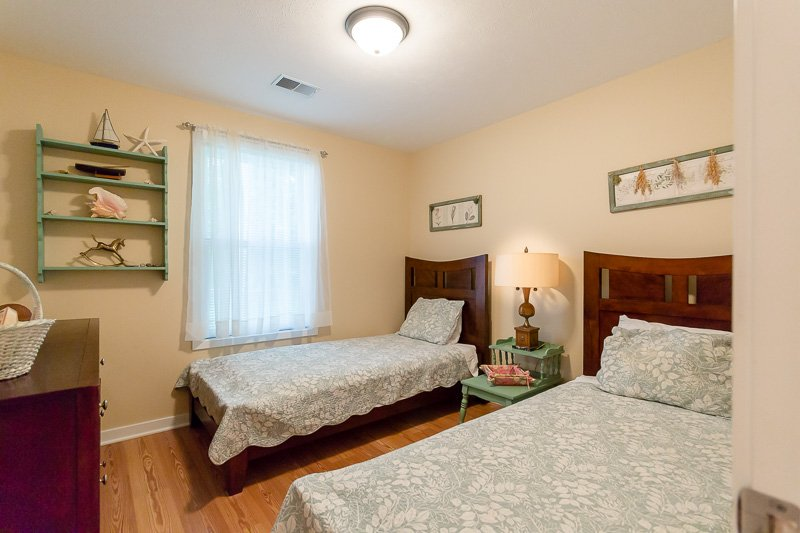 Kid's bedroom with two twin-sized beds