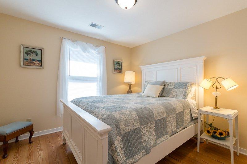 Quaint bedroom with queen-sized bed