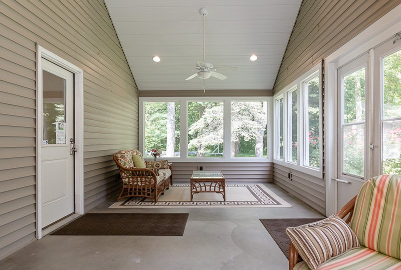Screened-in front porch perfect for morning coffee