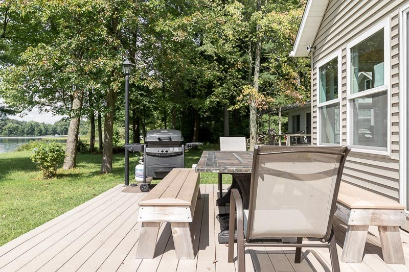 Large back porch with grill and al fresco family dining