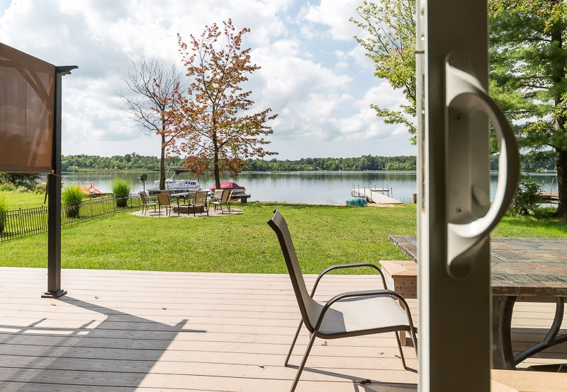 View of the backyard and lake, and access to the back porch, from Great Room