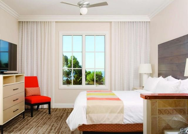 The master suite features a king-size bed and ensuite bath