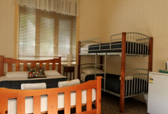 Queen Bed and Bunk Bed for this Family Suite Room that can accommodate up to 4 sleeps.