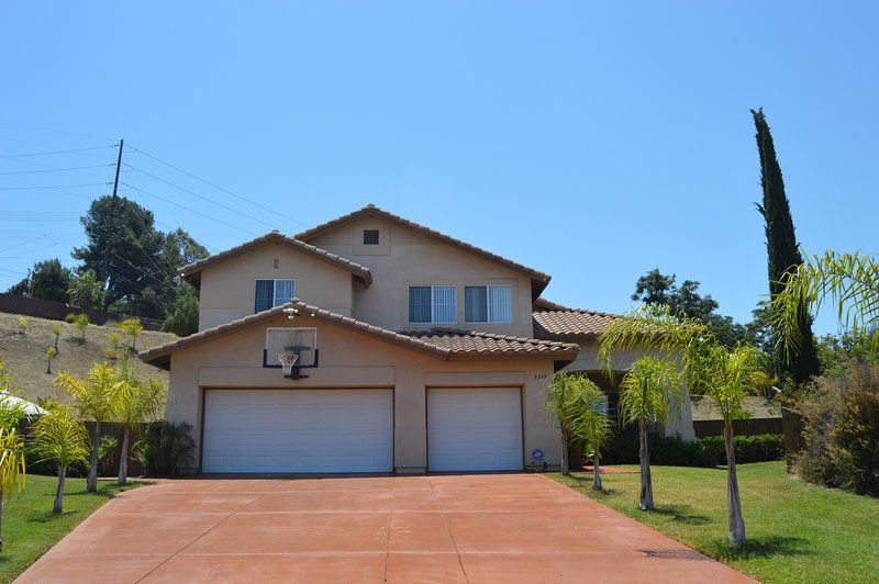 Front of House - Large Driveway and Basketball Hoop