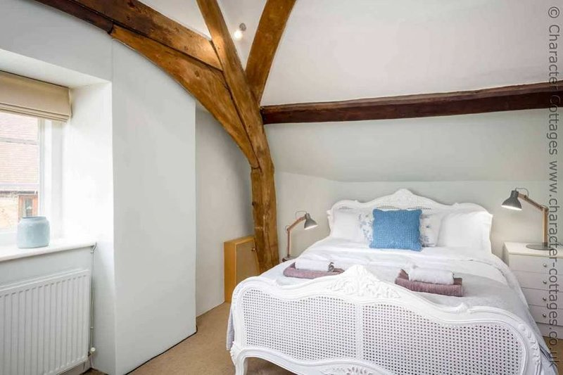 Bedroom 1, with beautiful oak beams and a king size bed