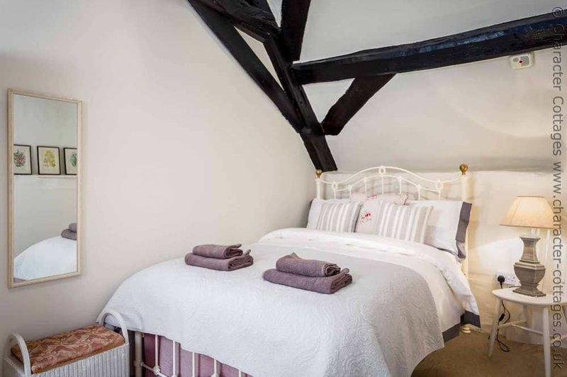 Dormitorio 2, que contiene una cama doble