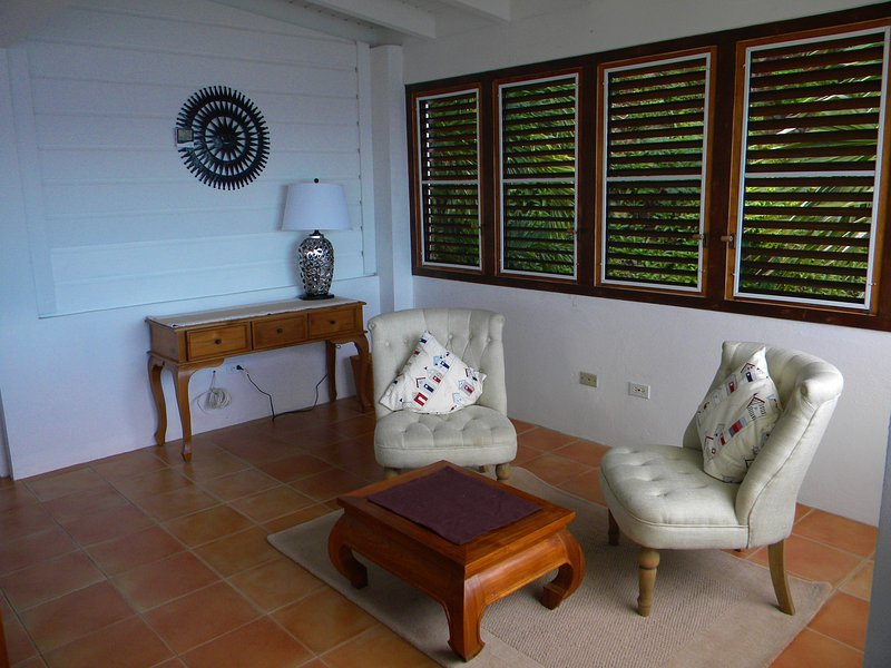 Dressing area of master bedroom with traditional hard wood louvres giving natural breeze.