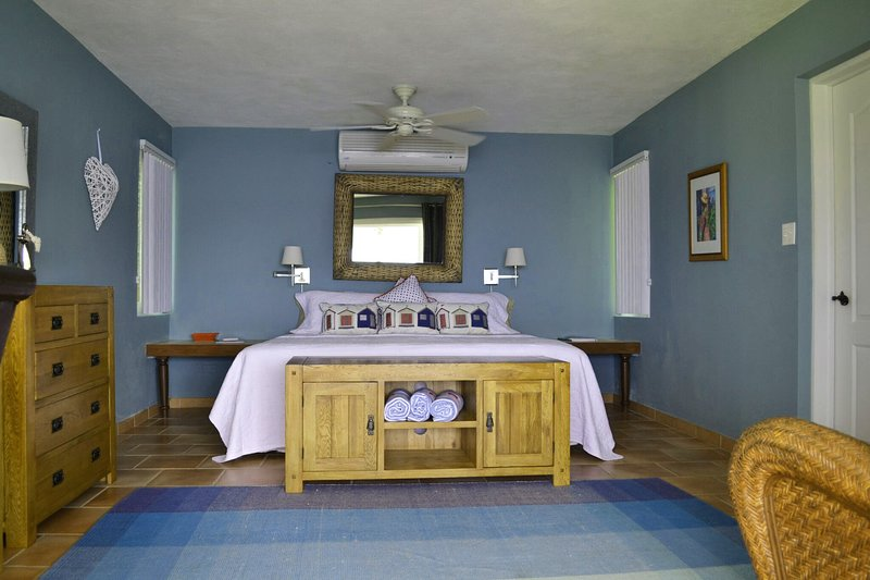 Lower bedroom, all have new modern screened windows and air conditioning. Oak furniture from UK
