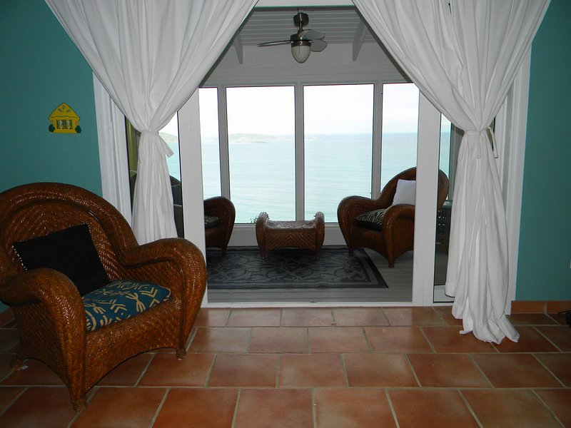 Screened veranda area for the second bedroom. Great for morning coffee or evening reading