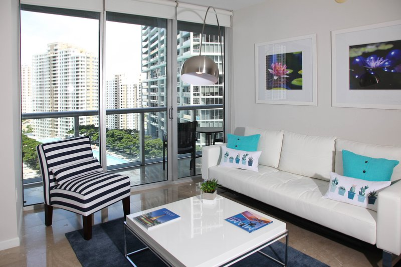 Floor to ceiling windows to enjoy the view. Clean, modern furniture