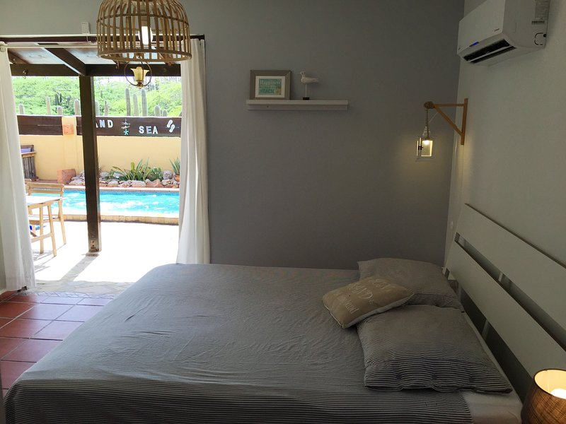 Masterbedroom with the doors open to the pool