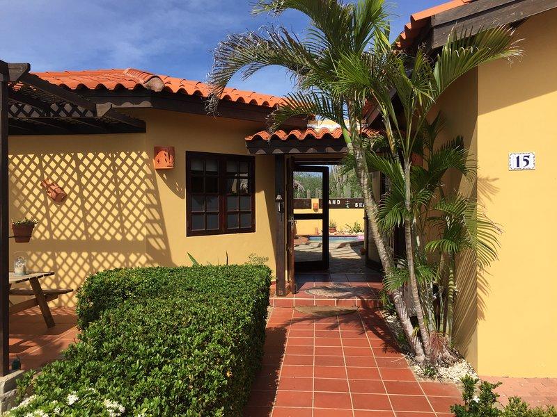 Entrance of Villa Tibushi Aruba, with the doors open  towards the pool