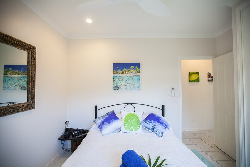 Bedroom 2 with Air Con, TV, Remote controlled Ceiling fan, Wardrobe with hangers, Mirror.