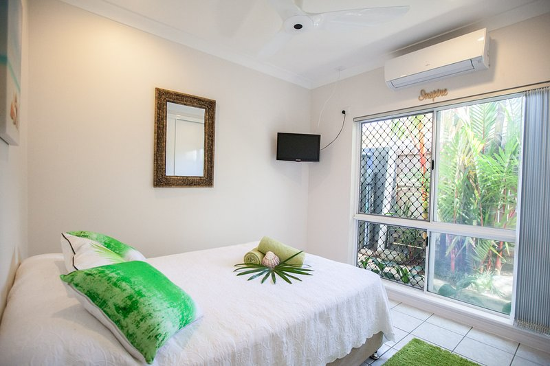 Bedroom 3 with Air Con, Remote Ceiling Fan, TV, Wardrobe with Hangers, Mirror.