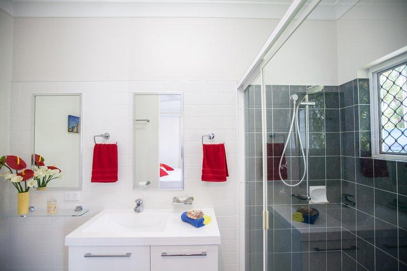 En suite bathroom off main, Shower with rotating shower head, Single vanity, toilet, Hair Dryer.