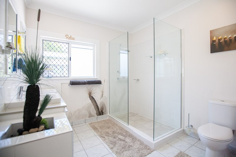 Main bathroom, Shower with rotating shower head, toilet, double vanity, Hair Dryer.