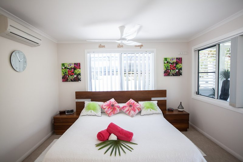 Master Retreat Bedroom with King Size bed, reading Lamps, Clock Radio. it is all there for you.