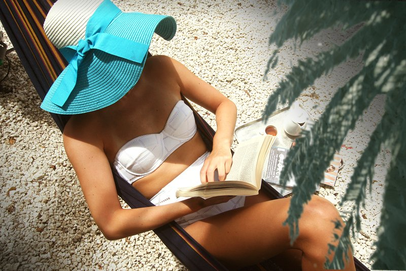Relaxing with a book in the hammock.