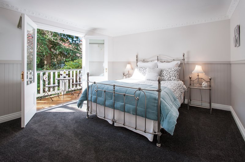 The gorgeous main bedroom has double French doors opening onto a private balcony